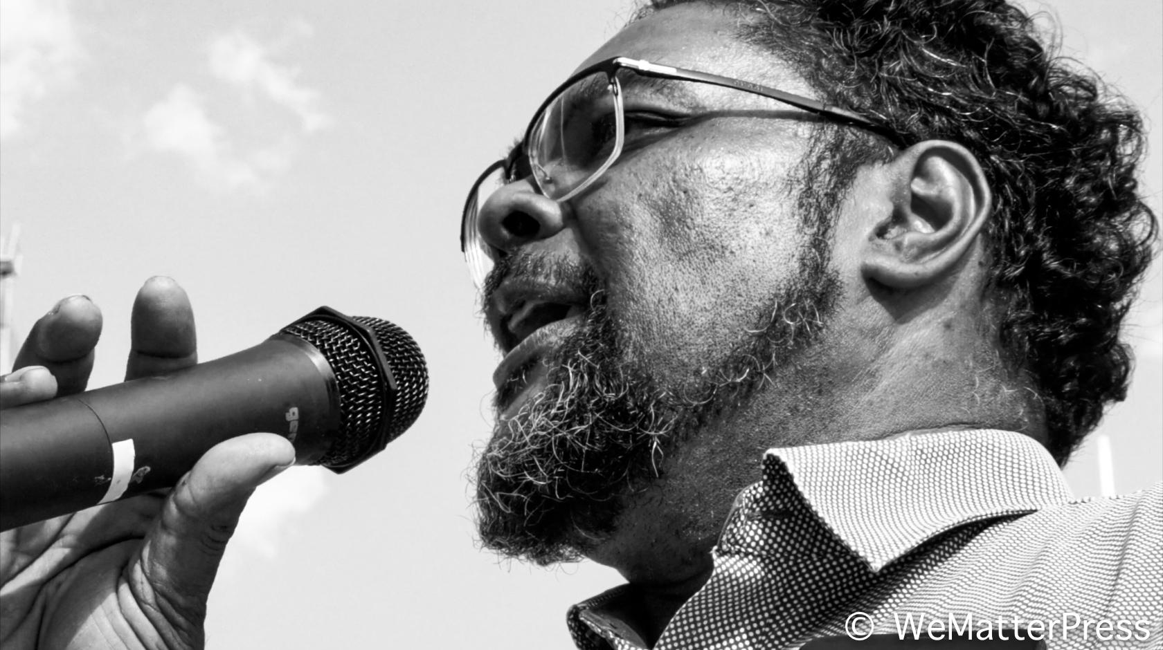 Desmond Jaddoo speaking at a public event